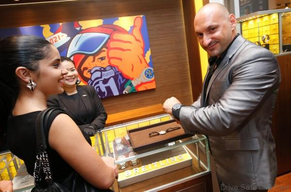 Guests admiring a Breitling timepiece