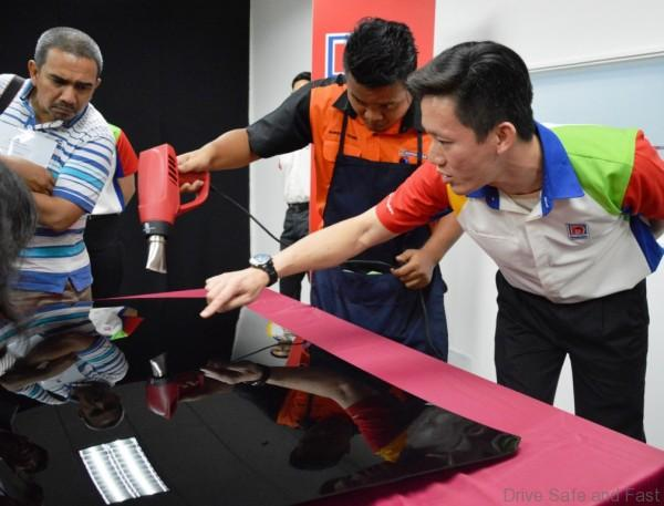 Mr. Lam Wai Keong, Assistant Tech Manager of Nippon Paint Malaysia demonstrating the self-healing properties of CyGLAZ technology