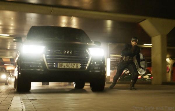 Captain America (Chris Evans) besides an Audi SQ7.