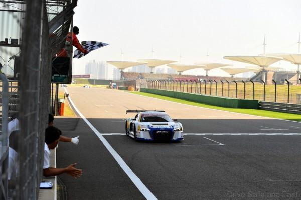 Alex Yoong (MAL) Audi TEDA Racing Team crosses the line & takes the flag for 2nd Position in Race1 at Audi R8 LMS Cup, Rd11 and Rd12, Shanghai International Circuit, Shanghai, China, 4-5 November 2016.