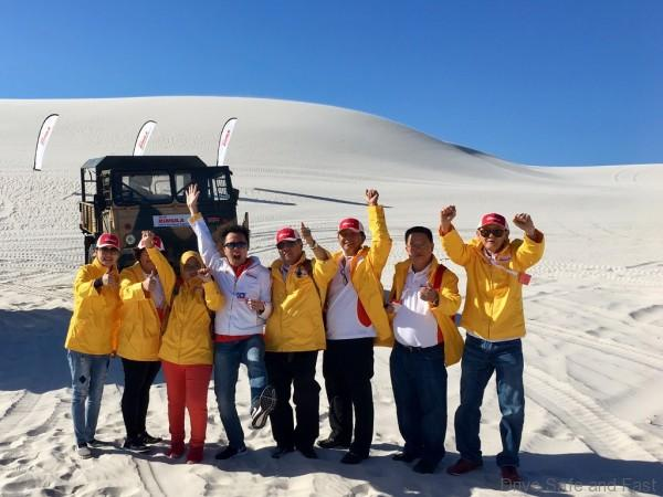 shell-rimula-global-promotions-winners-at-a-sand-dune-outside-cape-town